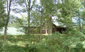 view of cabin from the road