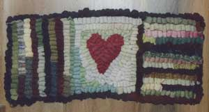 My first Rug, a primitive heart